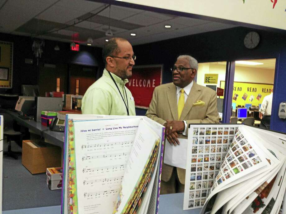 BRIAN ZAHN — NEW HAVEN REGISTER  Strong School teacher Carlos Reyes-Couvertier speaks with Interim Superintendent of Schools Reginald Mayo. Photo: Digital First Media