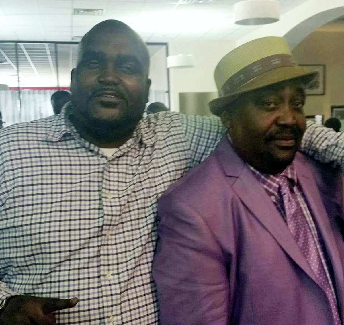 This undated photo provided by the Parks & Crump, LLC shows Terence Crutcher, left, with his father, Joey Crutcher. Crutcher, an unarmed black man, was killed by a white Oklahoma officer on Sept. 16, 2016 who was responding to a stalled vehicle.