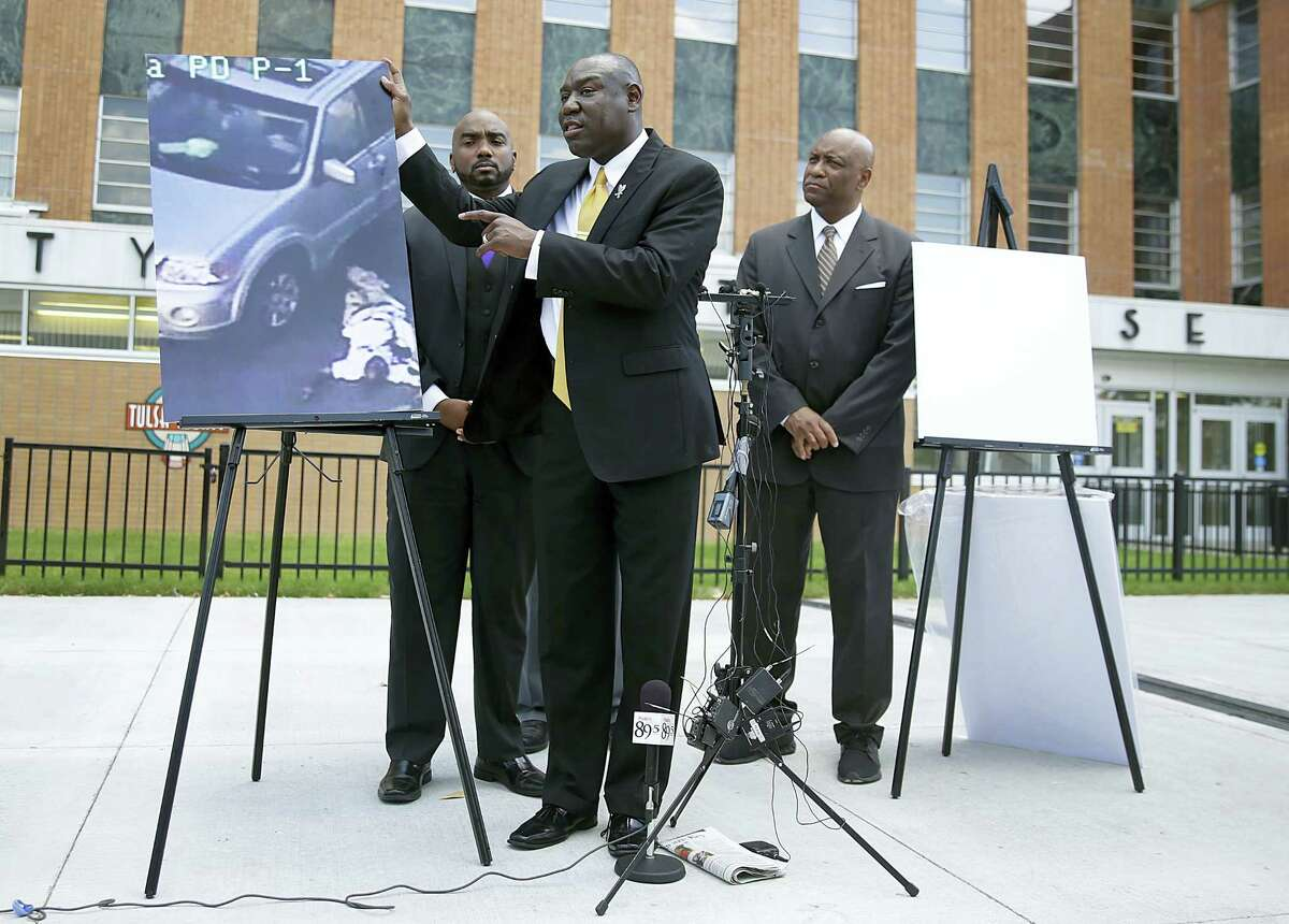 Attorney Benjamin Crump, center, one of the attorneys for Crutcher's family, speaks about Terence Crutcher during a news conference on Sept. 20, 2016 in Tulsa, Okla. Also pictured are attorneys David Riggs, left, Damario Solomon-Simmons and Melvin C. Hall.