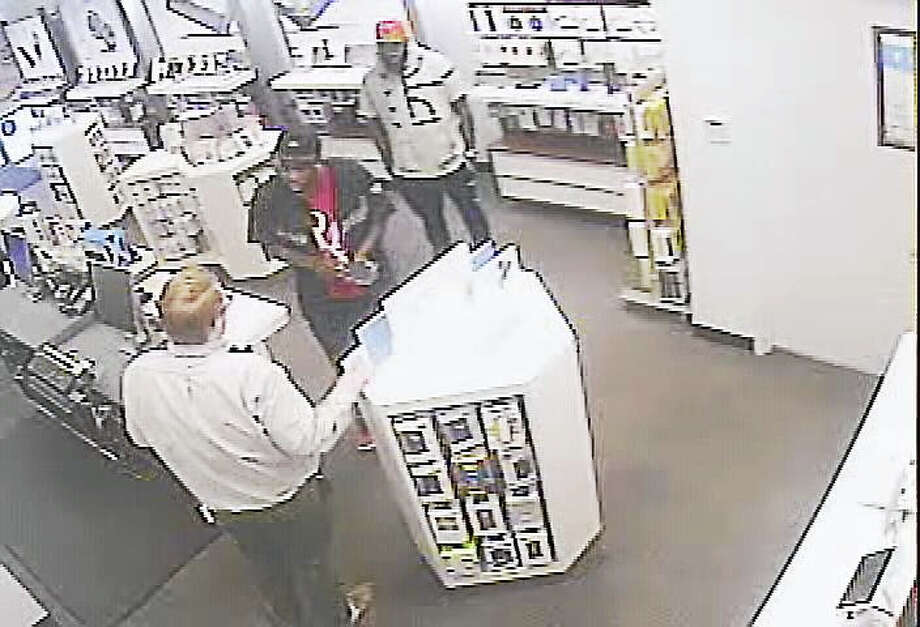 Courtesy Clinton PDPolice are attempting to identify two people accused of shoplifting in a Clinton AT&T store. Photo: Journal Register Co.