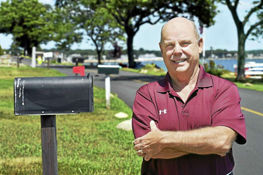 Retired mail carrier Ronnie Heins, is photographed on his old route on Linden Avenue in Branford. Heins retired a month earlier, after delivering mail on the same route to residents in Pawson Park for 30 years. Photo: Catherine Avalone — New Haven Register / New Haven RegisterThe Middletown Press