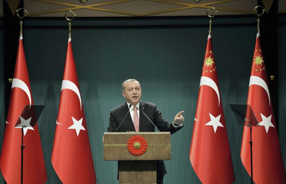 """Turkey's President Recep Tayyip Erdogan speaks after an emergency meeting of the government in Ankara, Turkey, late Wednesday, July 20, 2016. Erdogan on Wednesday declared a three-month state of emergency following a botched coup attempt, declaring he would rid the military of the """"virus"""" of subversion and giving the government sweeping powers to expand a crackdown. Photo: AP Photo / Copyright 2016 The Associated Press. All rights reserved. This material may not be published, broadcast, rewritten or redistribu"""