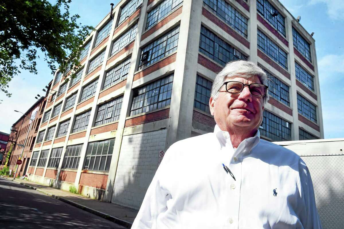 Lawrence Moon Jr., CEO of C. Cowles Co., is photographed in June 2015 in front of the series of buildings making up his business in New Haven.