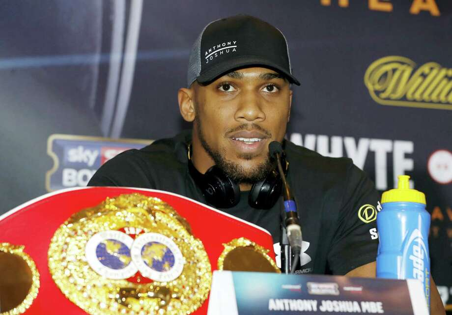 Britain's Anthony Joshua speaks during a press conference in Manchester, England on Dec. 8, 2016 ahead of his IBF world heavyweight fight against U.S fighter Eric Molina in Manchester on Saturday. Photo: Martin Rickett/PA Via AP   / PA