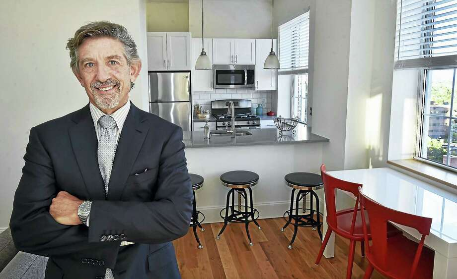 Developer David Kuperberg, in a two-bedroom apartment on the 11th floor of the Union Residences at 205 Church St. in New Haven. Photo: Catherine Avalone — New Haven Register   / New Haven RegisterThe Middletown Press