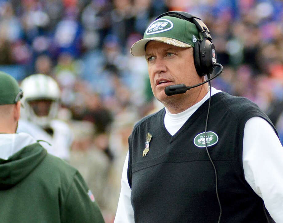 New York Jets head coach Rex Ryan walks on the sidelines during the first half of an NFL football game against the Buffalo Bills on Nov. 17, 2013 in Orchard Park, N.Y. Buffalo won 37-14. Photo: AP Photo/Heather Ainsworth   / FR120665 AP