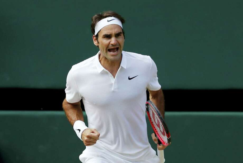 Roger Federer of Switzerland celebrates a point against Marin Cilic of Croatia during their men's singles match on day ten of the Wimbledon Tennis Championships in London on July 6, 2016. Photo: AP Photo/Ben Curtis   / Copyright 2016 The Associated Press. All rights reserved. This material may not be published, broadcast, rewritten or redistribu