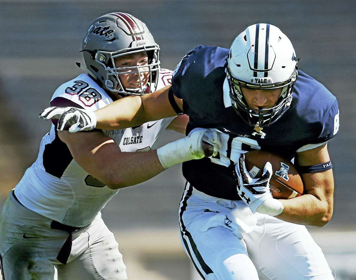Yale tight end John Lager is tackled by Colgate's Kyle Diener in a 55-13 victory for the Raiders in the seasoner opener Saturday, September 17, 2016, at the Yale Bowl in New Haven.