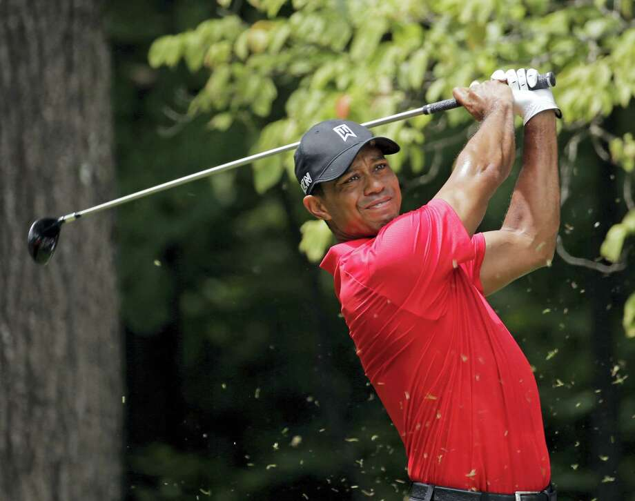 In this Aug. 23, 2015, file photo, Tiger Woods watches his tee shot on the second hole during the final round of the Wyndham Championship golf tournament. Woods withdrew from the PGA Championship Tuesday, the first time he will go an entire year without playing a major. He will miss the remainder of the PGA Tour season. Photo: CHUCK BURTON — THE ASSOCIATED PRESS   / Copyright 2016 The Associated Press. All rights reserved. This material may not be published, broadcast, rewritten or redistribu