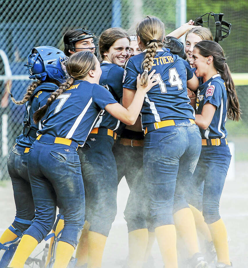Seymour Little League Girls 11-12 softball team celebrates their 6-1 championship win over North Branford Tuesday evening in Simsbury. Seymour advances to the Little League World Series East Region tournament and will play Saturday evening in Bristol. Photo: JOHN VANACORE — REGISTER