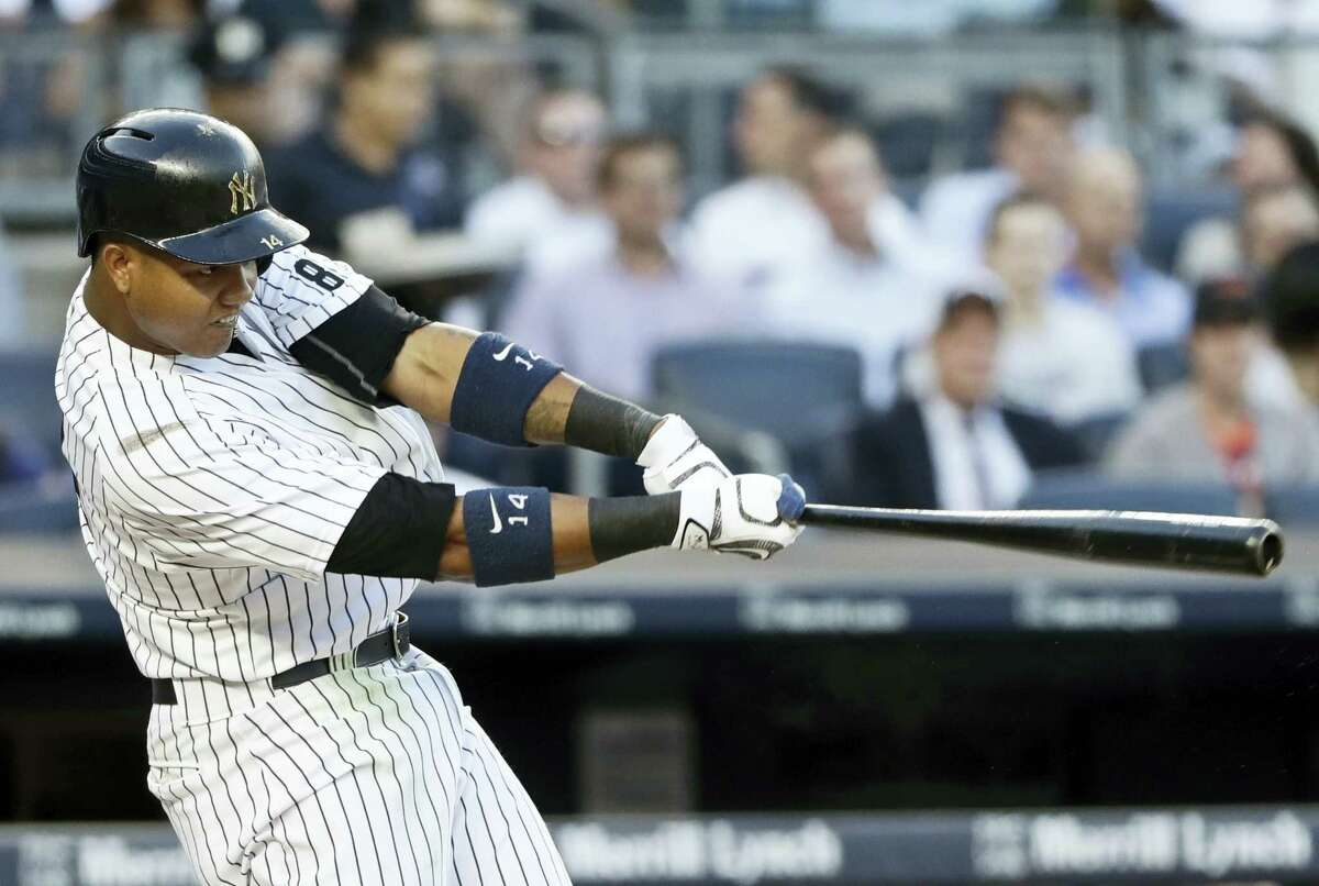 New York'S Starlin Castro follows through on a two-run home run during the second inning against the Baltimore Orioles Tuesday. Castro drove in four as the Yankees beat the Orioles 7-1.