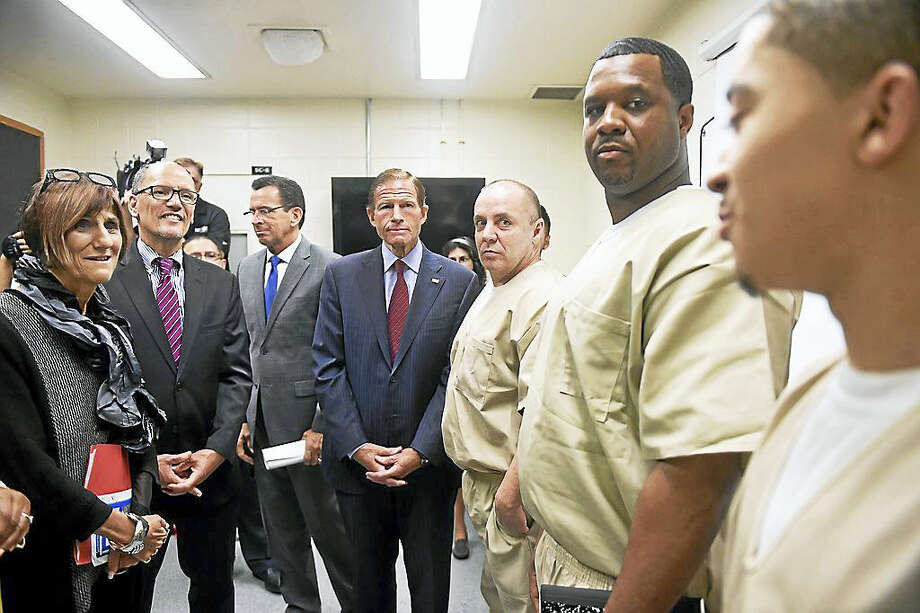 U.S. Secretary of Labor Thomas Perez joined other state and local politicians and officials Tuesday to visit the New Haven Community Correctional Center meeting with inmates involved with job training programs. Photo: Photo By Arnold Gold/New Haven Register