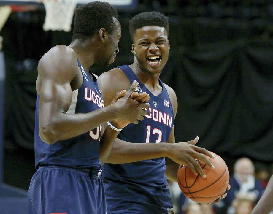 UConn's Amida Brimah and Steve Enoch laugh during the UConn men's and women's First Night event last Friday in Storrs. Photo: JESSICA HILL — The Associated Press   / AP2016