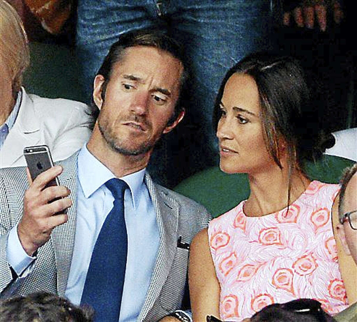 This is a July 6, 2016, file photo of Pippa Middleton and James Matthews on day nine of the Wimbledon Championships at the All England Lawn Tennis and Croquet Club, Wimbledon London. Pippa Middleton and fund manager James Matthews on Tuesday July 19, 2016 announced their engagement.