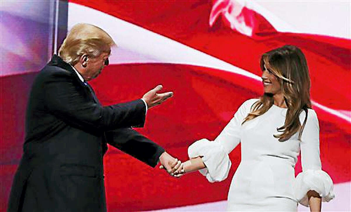 Republican presidential candidate Donald Trump, right, acknowledges his wife, Melania, as they walk off stage during the Republican National Convention, Monday, July 18, 2016, in Cleveland.