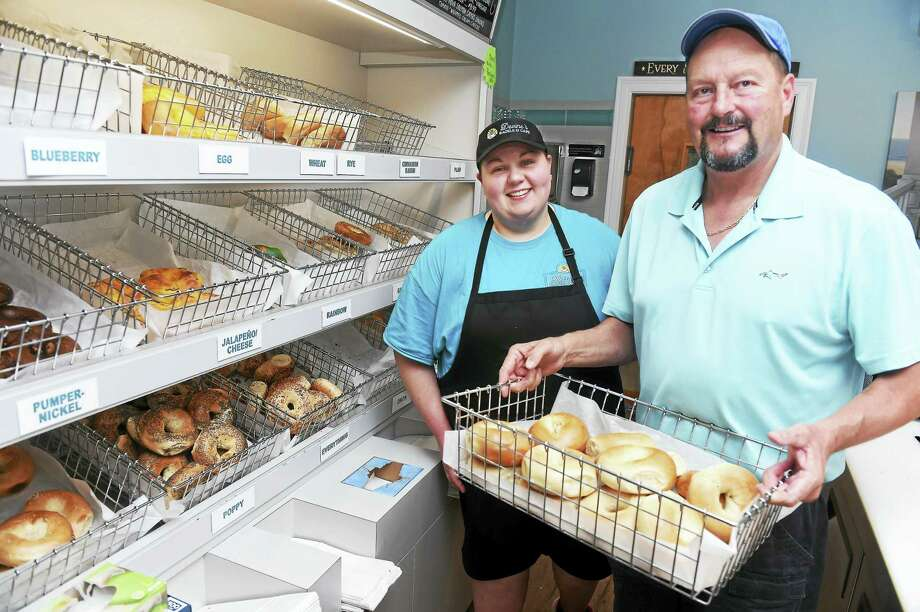 Manager Monica Baran, left, with Patrick Devine, owner of Devine's Bagels and Cafe in Milford. Photo: Arnold Gold — New Haven Register