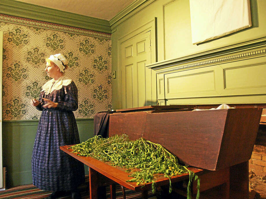 Interpreter Linda and a coffin from Colonial times. Photo: Photo Courtesy Of WDS Museum