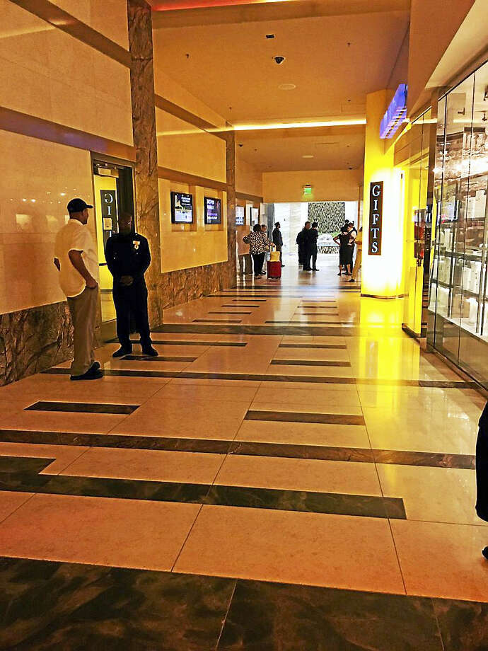 Law enforcement officers guard doors following an officer-involved shooting incident at a Foxwoods Casino parking garage on Tuesday, Sept. 20, 2016. Photo: Courtesy Of Evan Cummins