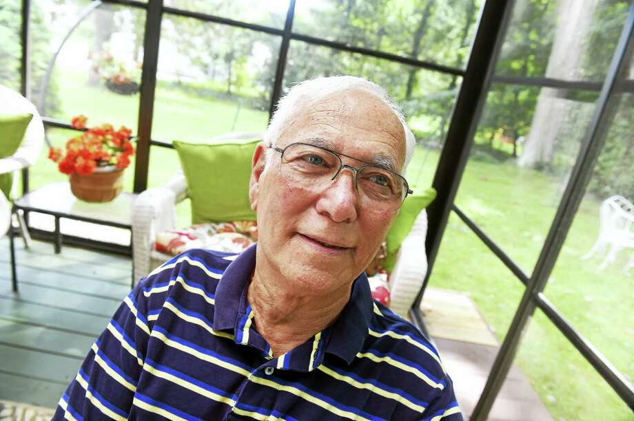 Kidney recipient Nathan Smith of Orange is photographed on his backyard deck. Photo: Arnold Gold — New Haven Register