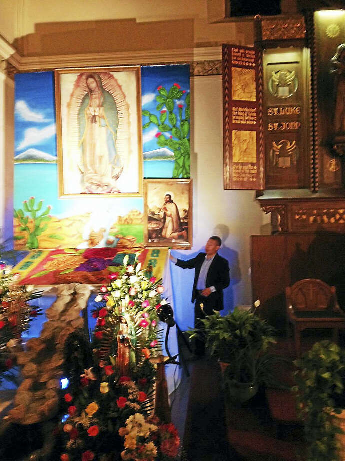 Randall Beach -- New Haven Register  Cecilio Cuapio underneath a likeness of Our Lady of Guadalupe, top left. Photo: Digital First Media