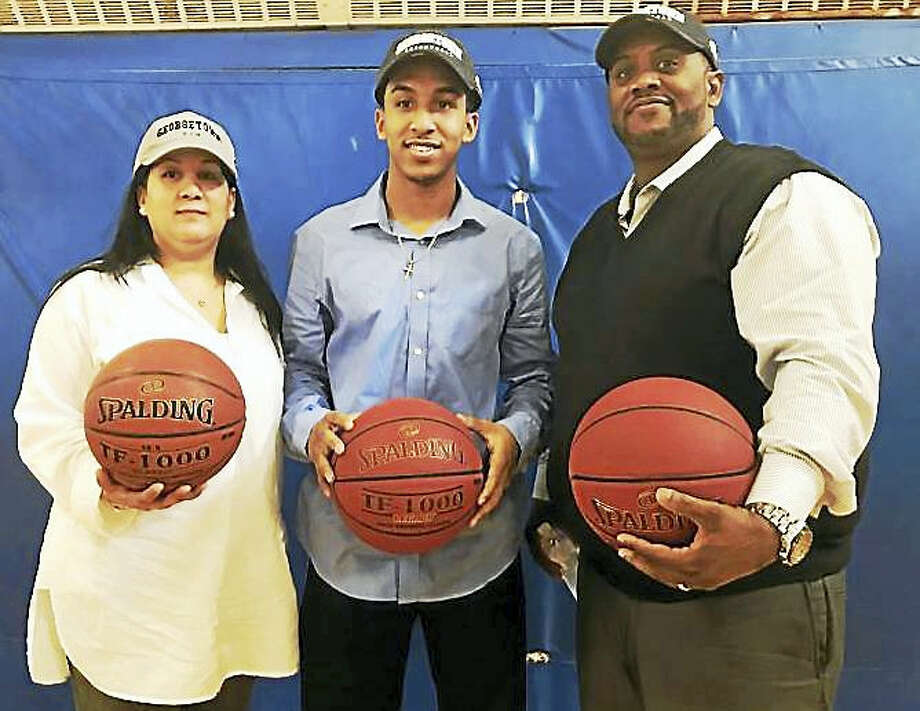 New Haven resident Tremont Waters, a senior point guard at Notre Dame High School, made a verbal commitment Wednesday to play college basketball at Georgetown University. Waters announced his decision with his parents, Vanessa and Edward Waters, at Farnam Neighborhood House on Fillmore Street in New Haven. Photo: Catherine Avalone — New Haven Register