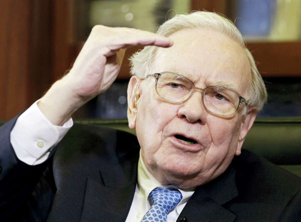 In this May 5, 2014 photo, Berkshire Hathaway Chairman and CEO Warren Buffett gestures during an interview with Liz Claman on the Fox Business Network in Omaha, Neb.