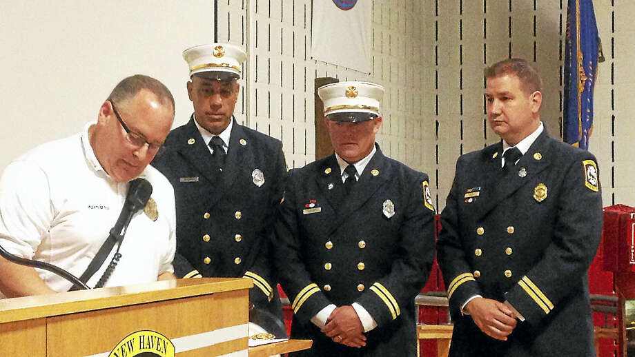 From left, New Haven Fire Department Acting Chief Matthew Marcarelli, Battalion Chiefs Mark Vendetto, Tim Keiley and Frank Ricci during a promotional ceremony Tuesday at the Fire Department Academy. Photo: Juliemar Ortiz — New Haven Register