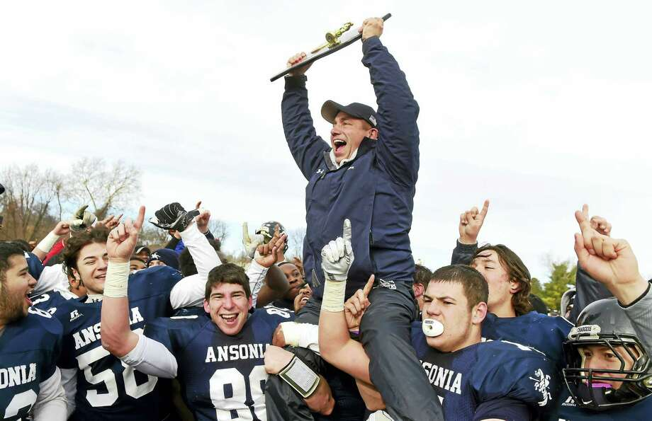 Peter Hvizdak — Register   Ansonia coach Tom Brockett celebrates with his players and the championship trophy after defeating Rocky Hill H.S. during the 2016 CIAC Class S Football State Championship with a final score of  28-21 Saturday, December 10, 2016, at New Britain Stadium in New Britain, Connecticut  and winning Ansonia's 20th high school football championship. Photo: ©2016 Peter Hvizdak / ©2016 Peter Hvizdak