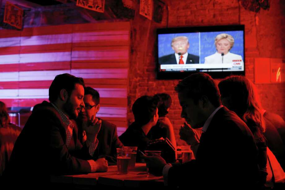 Customers watch the third and last U.S. presidential debate at the Pinche Gringo BBQ restaurant in Mexico City Wednesday. Photo: The Associated Press   / Copyright 2016 The Associated Press. All rights reserved.