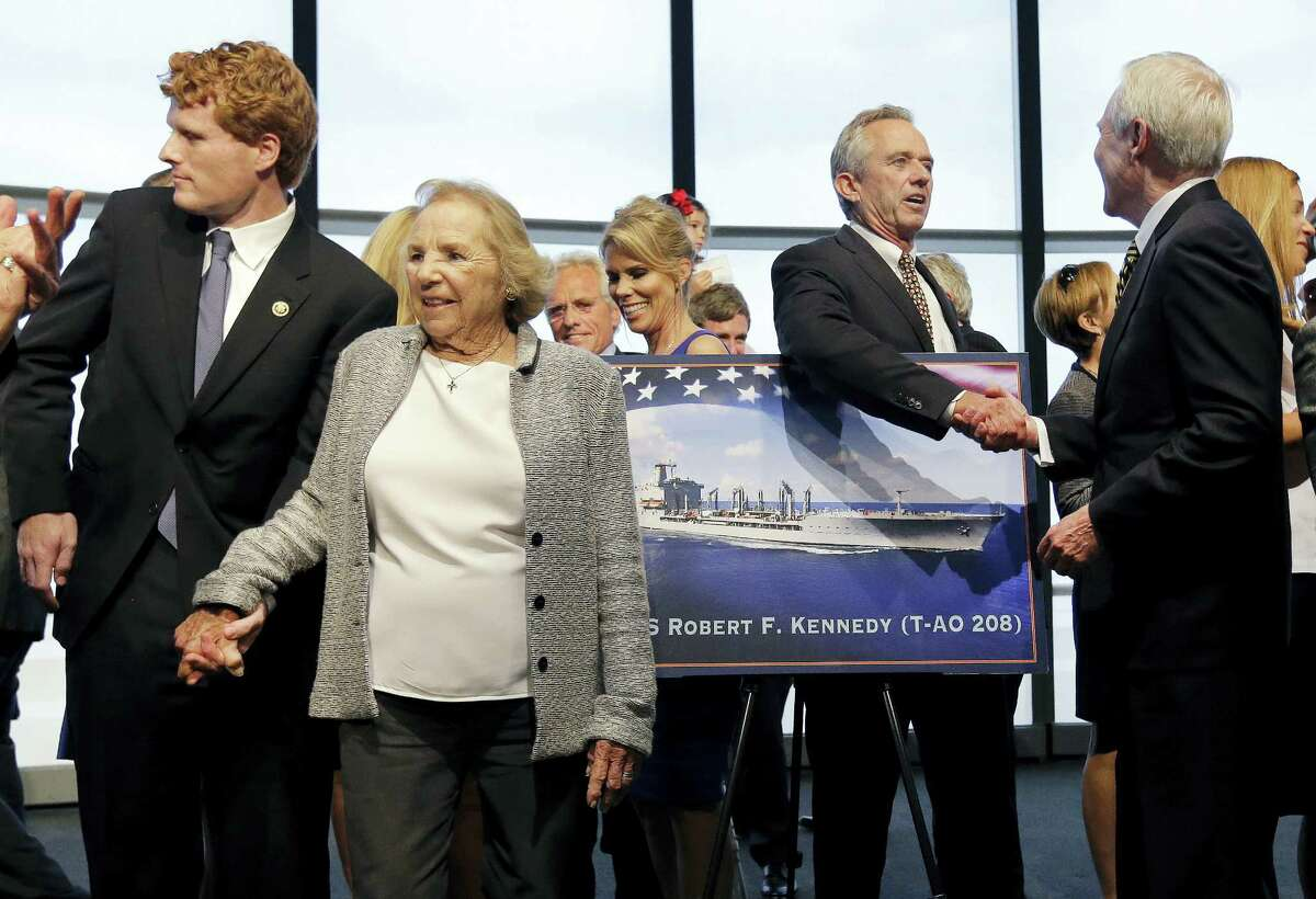 Ethel Kennedy, widow of Sen. Robert F. Kennedy, holds hands with grandson Joseph P. Kennedy III, left, while Robert F. Kennedy Jr. shakes hands with Navy Secretary Ray Mabus, right, as they gather with family members to pose near a rendering of the Robert F. Kennedy Navy Ship named at the John F. Kennedy Presidential Library, Tuesday, Sept. 20, 2016, in Boston. The new ship's job will be to restock and refuel other ships already at sea. Ships in this class are being named in honor of civil and human rights heroes.