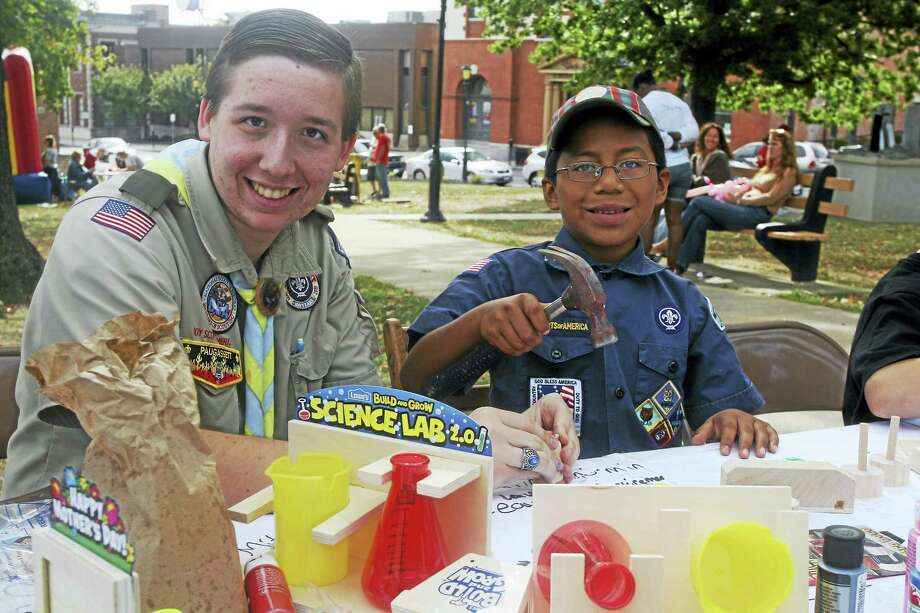 Photo - Randy Ritter   Left to right, Troop 3 Assistant Scoutmaster Joseph Szewczyk assisting Pack 3 Cub Scout Anthony Sullivan in building craft projects donated by Lowes during the 2015 Ed Strang Day. Photo: Journal Register Co.