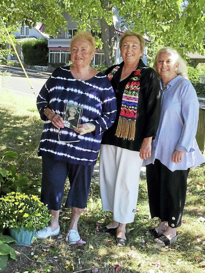"From left, Marietta Coppola, Paula DAgostino and Michelle Lettieri hold a picture of their mother, Julia ""Nana"" Coppola, who was killed by a drunken driver in 1993. Photo: Contributed Photo"