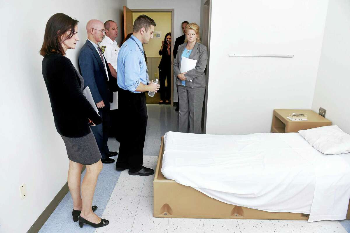 U.S. Attorney Deirdre Daly, l, views a room in the acute care unit of South Central Rehabilitation Center in New Haven during a tour.