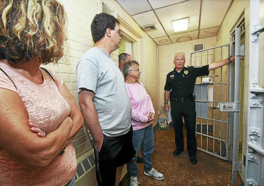 Ansonia Police Chief Kevin Hale show residents the antiquated holding cells at police headquarters Wednesday during a public tour of the facility. Photo: Catherine Avalone — New Haven Register   / New Haven RegisterThe Middletown Press