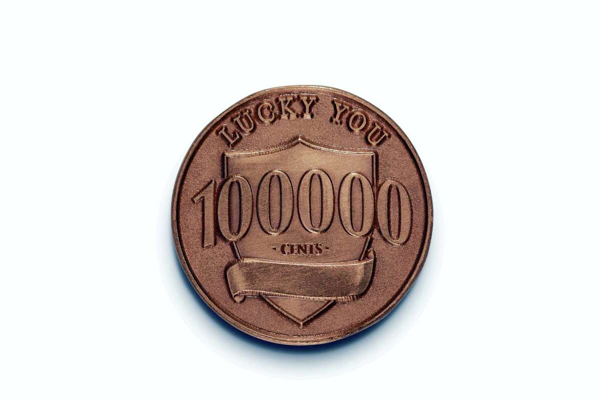 """This photo provided by Ally Bank shows a fake penny that is part of Ally Bank's """"Lucky Penny"""" promotion. The bank placed 100 fake pennies worth $1,000 apiece across the country. The lucky pennies are a copper color, like real pennies, but feature the Detroit-based bank's logo instead of Abraham Lincoln's head. The flip side of the coin lists its value at 100,000 cents."""