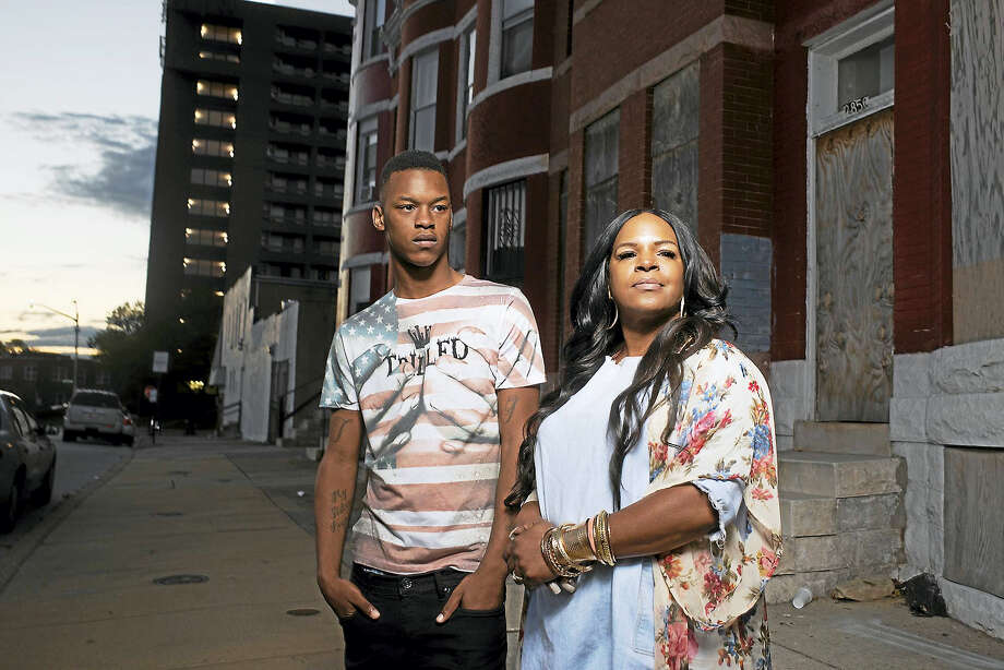 Michael Singleton with his renowned mother Toya Graham outside their Baltimore home last year. She became an internet sensation during the riots in 2015. Photo: Marvin Joseph — The Washington Post / The Washington Post