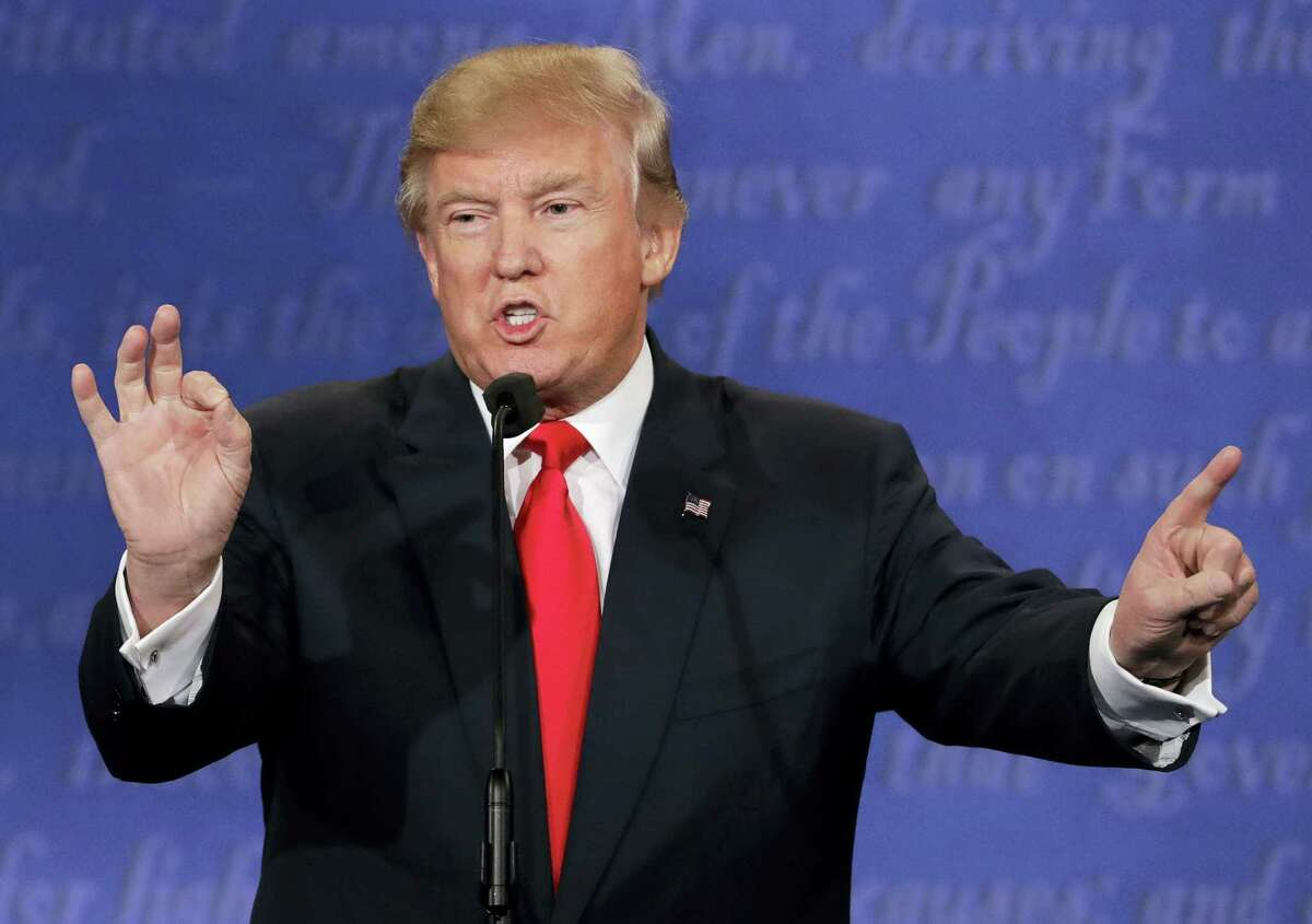 Republican presidential nominee Donald Trump speaks during the third presidential debate with Democratic presidential nominee Hillary Clinton at UNLV in Las Vegas Wednesday.