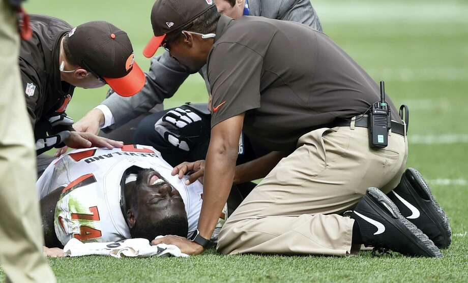 In this Sept. 18, 2016 photo, Cleveland Browns center Cameron Erving (74) is looked at by medical personnel late in the fourth quarter of an NFL football game against the Baltimore Ravens, in Cleveland. Erving has been released from the hospital after sustaining a bruised lung. Photo: AP Photo/David Richard, File   / FR25496 AP