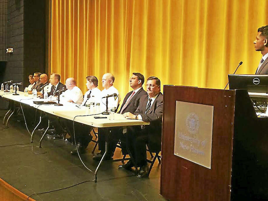 "Area mayors and police chiefs on the panel at Tuesday night's ""community conversation"" on race and policing at University of New Haven. Photo: MARK ZARETSKY — NEW HAVEN REGISTER"