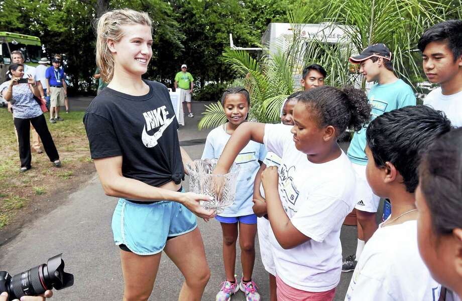 (Arnold Gold-New Haven Register)  Genie Bouchard (left) of Canada gets assistance from Yaelian Hernandez, 10, of NewHYTEs (New Haven Youth Tennis & Education), with the draw for the Connecticut Open on 8/19/2016. Photo: Journal Register Co.