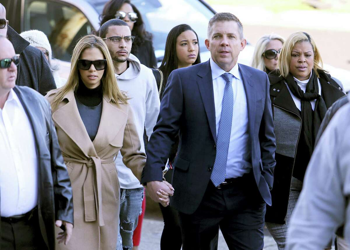New Orleans Saints head coach Sean Payton walks with Will Smith's widow Racquel into Orleans Criminal Court for the trial of Cardell Hayes on Saturday, Dec. 10, 2016, in New Orleans. Hayes killed Will Smith in a road rage incident, in which Smith's wife was also shot and wounded.
