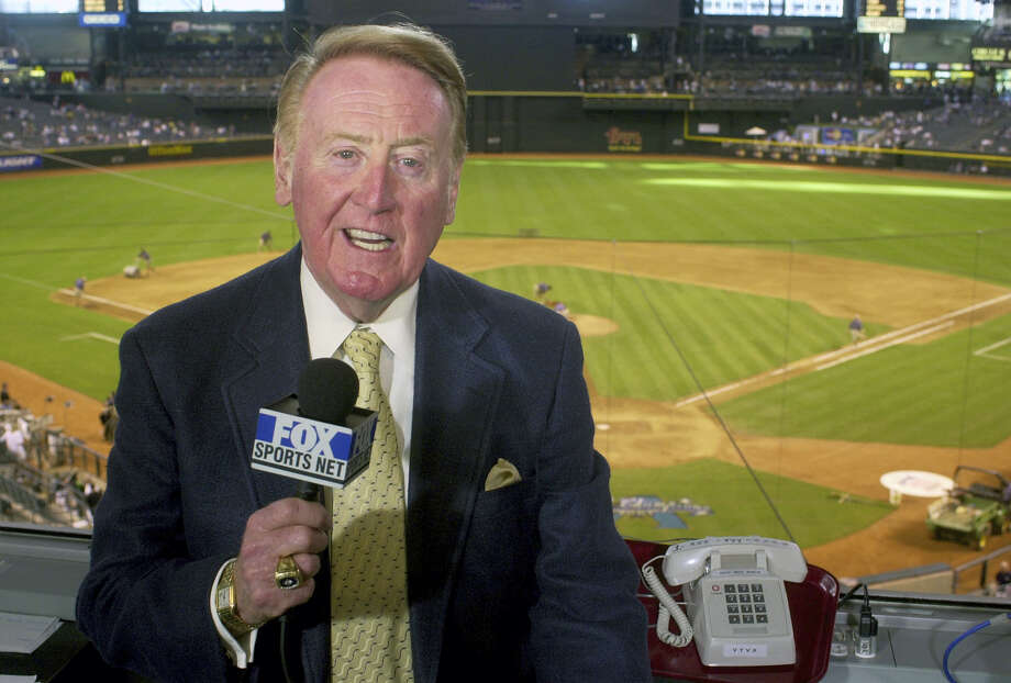 Los Angeles Dodgers television play-by-play announcer Vin Scully begins his final homestand behind the mic for the Los Angeles Dodgers on Monday night. Photo: Paul Connors — The Associated Press File   / AP2002