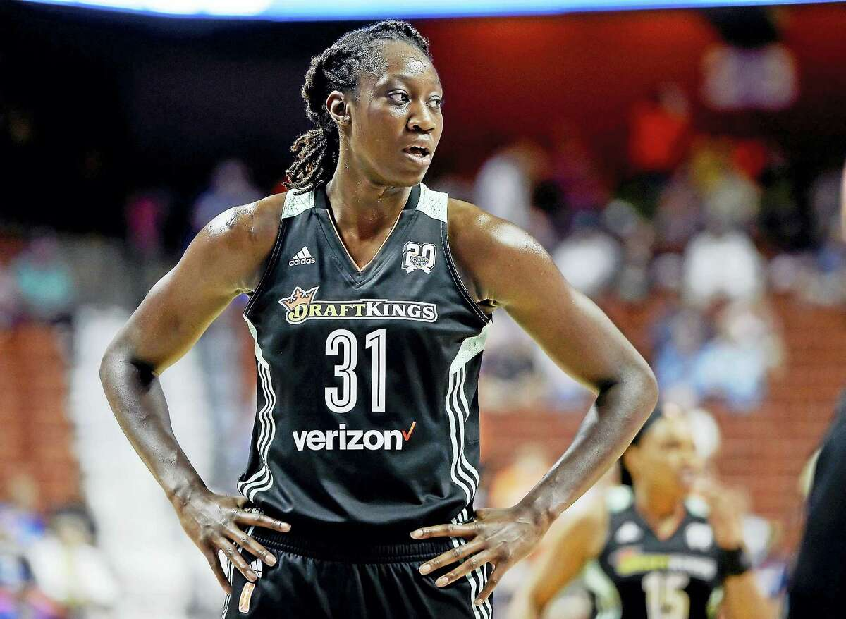 Former UConn star Tina Charles became just the second player in WNBA history to win the scoring and rebounding titles in the same season.