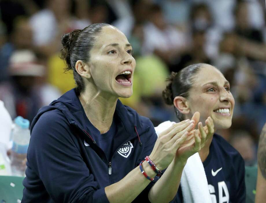 Sue Bird, left, cheers from the bench during the semifinal game against France on Thursday. Photo: Eric Gay — The Associated Press   / AP