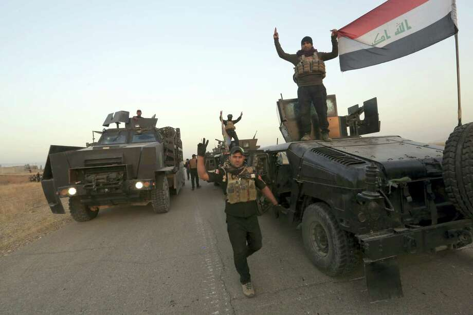 Members of Iraq's elite counterterrorism forces pose for a photo as they advance towards the city of Mosul, Iraq, Thursday, Oct. 20, 2016. Iraqi special forces charged into the Mosul battle Thursday with a pre-dawn advance on a nearby town held by the Islamic State group, a key part of a multi-pronged assault on eastern approaches to the besieged city. Photo: Khalid Mohammed — AP Photo / Copyright 2016 The Associated Press. All rights reserved.