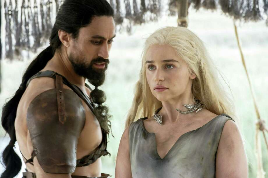 "This image released by HBO shows Joe Naufahu, left, and Emilia Clarke in a scene from the season six premiere of ""Game of Thrones."" Photo: Macall B. Polay/HBO Via AP   / HBO"