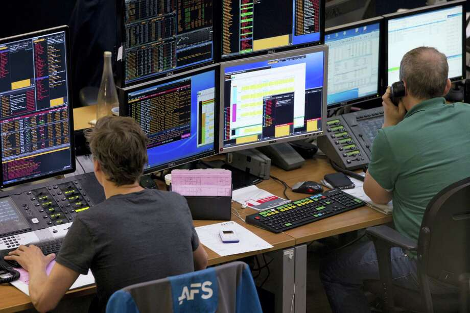 Two traders look at their screens as stocks plummeted following the British Brexit vote at the Euronext Amsterdam Stock Exchange, Netherlands on June 24, 2016. The British vote to leave the EU shook up financial markets around the globe on Monday, leading to sharp falls in stocks and the British pound. Photo: AP Photo/Peter Dejong   / AP 2016
