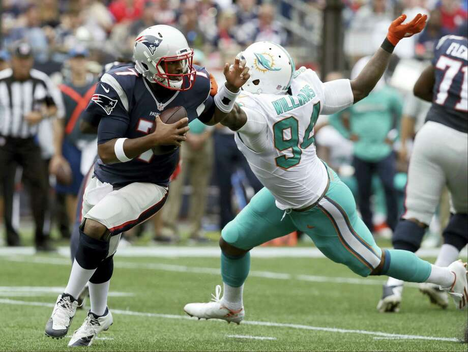New England Patriots quarterback Jacoby Brissett (7) scrambles away from Dolphins defensive end Mario Williams on Sunday. Photo: Charles Krupa — The Associated Press   / Copyright 2016 The Associated Press. All rights reserved.