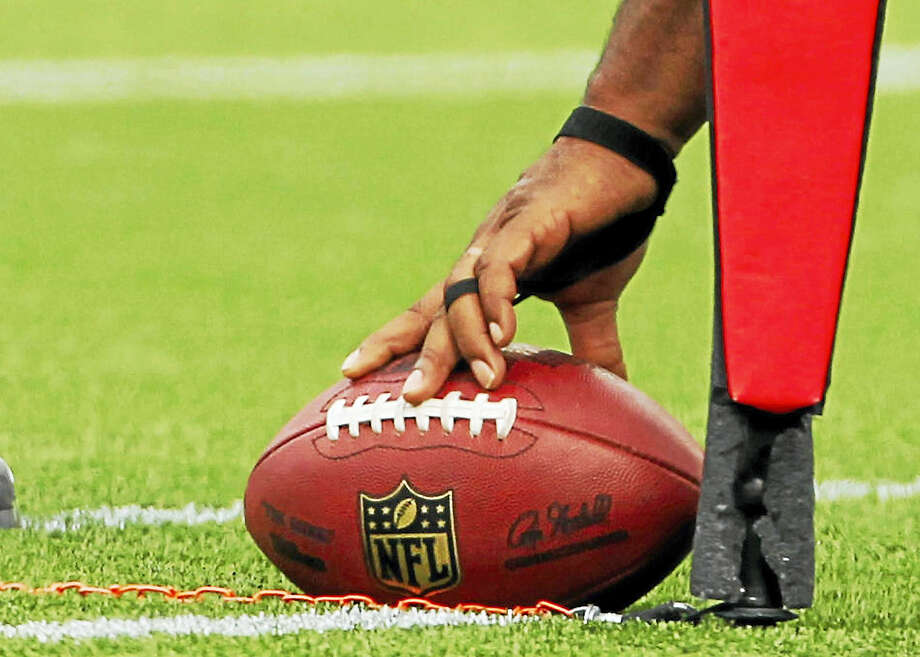 Data collected from the chips being tested in footballs this preseason could help with officiating in the future, including goal-line and short-yardage plays. Photo: The Associated Press File Photo   / AP