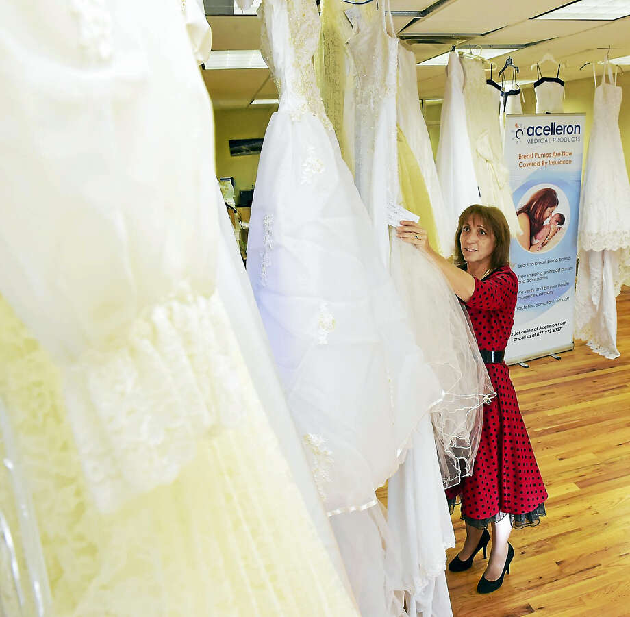 Jan Ferraro, childbirth educator at Acelleron Medical Products, collects donated weddings gowns in her Guilford office for the Kelly Ryan Foundation. The foundation remakes the wedding gowns into burial clothes from for infants who died prenatal or soon after being born. Photo: Peter Hvizdak — New Haven Register  / ©2016 Peter Hvizdak